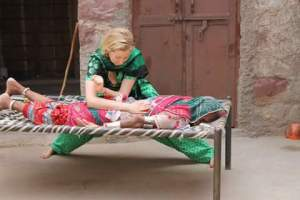 Using a villages bed to treat a patient.